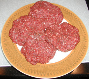 Bison burgers before cooking